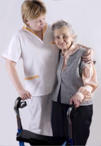 a woman caregiver hugging the senior woman